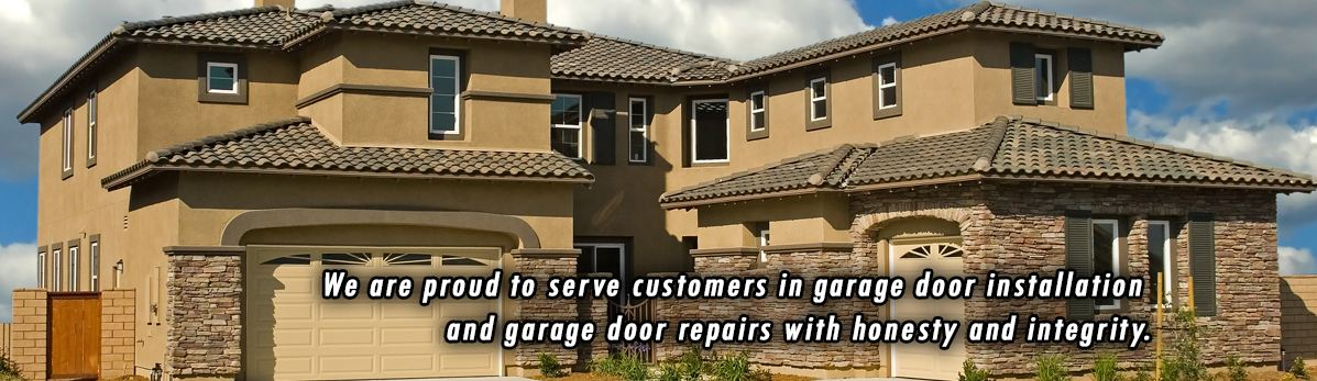 Matching tan garage doors installed by residential garage door repair company Aldor Sales, Inc. In Jacksonville, FL