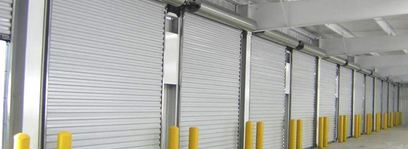 Several garage units representing the commercial roll-up doors offered by Aldor Sales, Inc. in Jacksonville, FL