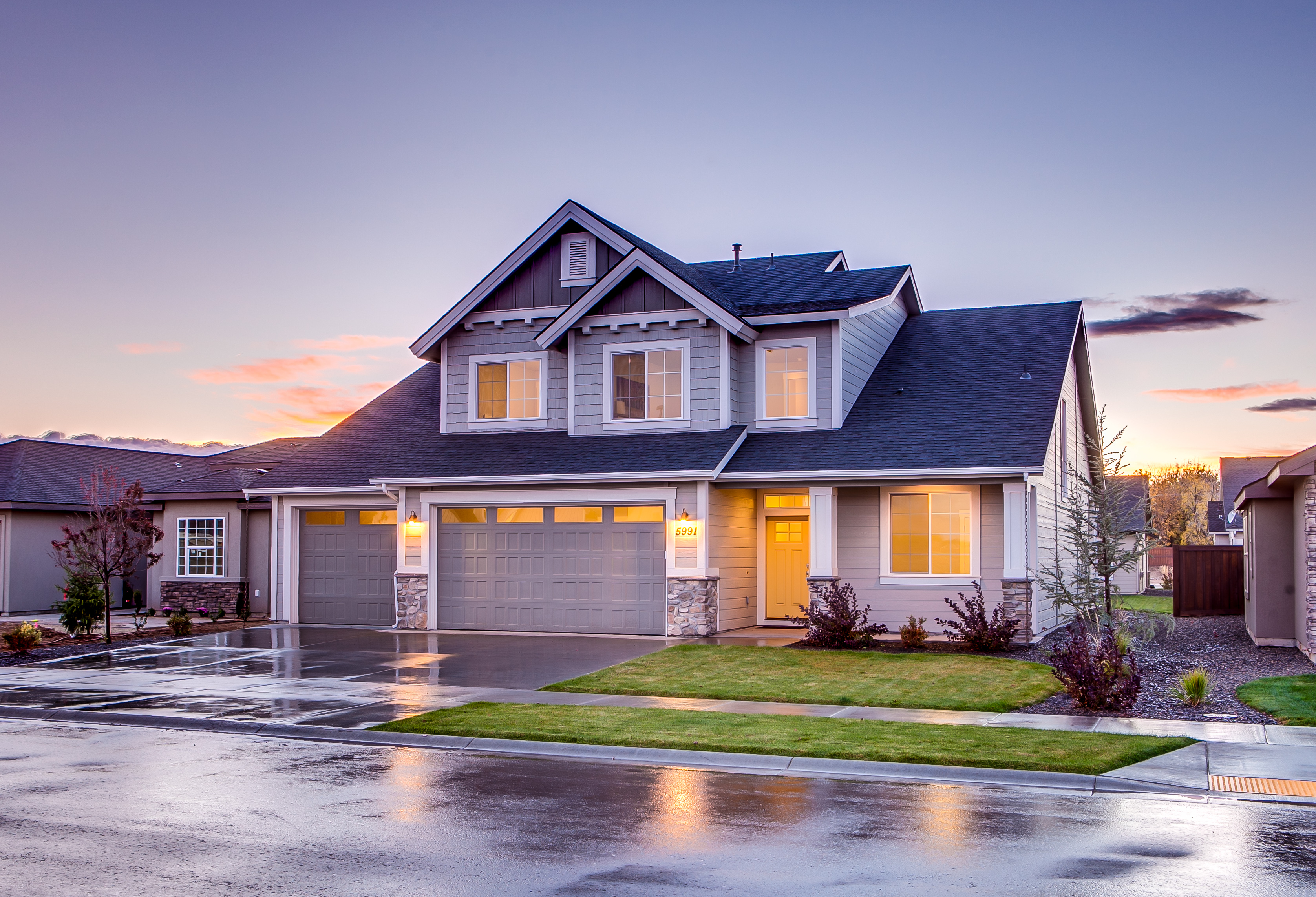 Canva - Blue and Gray Concrete House With Attic during Twilight